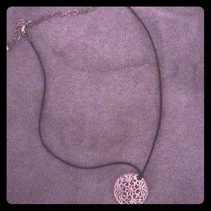 Simple choker with gold emblem